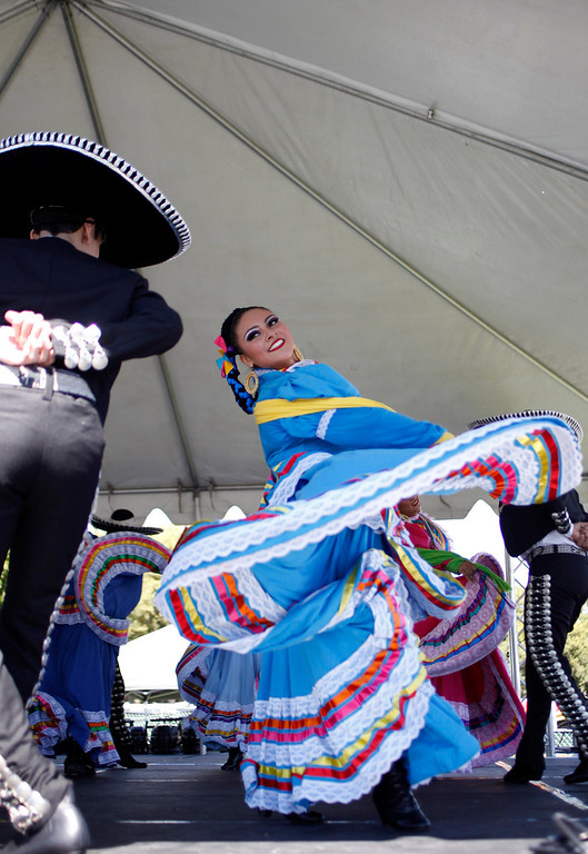 . Denise Ramos, 19, a member of Ballet Folklorico Mexicano de Carlos Moreno of Oakland performs at the ¡VivaFest!/El Grito music and cultural festival celebrating Mexico�s Independence Day at Discovery Meadow in San Jose, Calif., on Sunday, Sept. 15, 2013. (Josie Lepe/Bay Area News Group)
