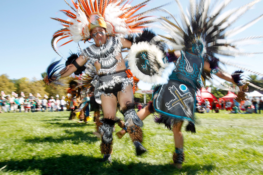 ". Raul Torres and  Abigail Del Carmen, 18, ""Cuauyohua\"" members of Aztec dance group Calpulli Tonalehqueh from the School of Arts and Culture, perform during the ¡VivaFest!/El Grito music and cultural festival celebrating Mexico�s Independence Day at Discovery Meadow in San Jose, Calif., on Sunday, Sept. 15, 2013. (Josie Lepe/Bay Area News Group)"