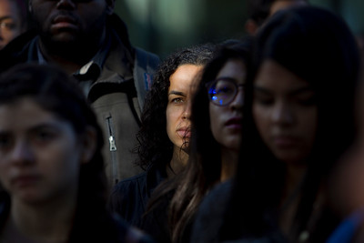 San Jose State University (SJSU) international business major Karina Alves, 28, center, attends a solidarity rally hosted by the Black Student Union in the wake of the racially charged incident at the University of Missouri, at San Jose State University in San Jose, Calif., on Wednesday, Nov. 18, 2015. (LiPo Ching/Bay Area News Group)