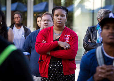 San Jose State University (SJSU) chemistry major Leslie Cooper, 18,  center, attends a solidarity rally hosted by the Black Student Union in the wake of the racially charged incident at the University of Missouri, at San Jose State University in San Jose, Calif., on Wednesday, Nov. 18, 2015. (LiPo Ching/Bay Area News Group)