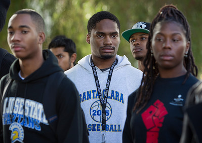 San Jose State University (SJSU) biochemistry major Kingsley Okakpu, 21, center, participates in a solidarity rally hosted by the Black Student Union in the wake of the racially charged incident at the University of Missouri, at San Jose State University in San Jose, Calif., on Wednesday, Nov. 18, 2015. (LiPo Ching/Bay Area News Group)