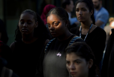 San Jose State University (SJSU) Student Involvement employee Emerald Green, 25, center, attends a solidarity rally hosted by the Black Student Union in the wake of the racially charged incident at the University of Missouri, at San Jose State University in San Jose, Calif., on Wednesday, Nov. 18, 2015. (LiPo Ching/Bay Area News Group)