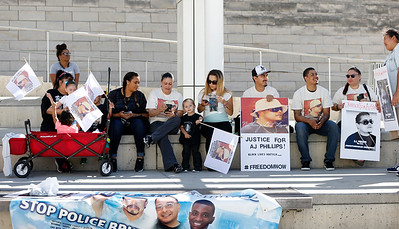 The family of AJ Phillips, along with supporters, hold posters as they gather before a rally on National Day of Action at San Jose City Hall in San Jose, Calif., on Thursday, July 21, 2016. (Josie Lepe/Bay Area News Group Archives)