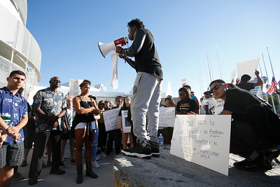 """Kenny Kuba, 17, of San Jose, speaks to the crowd as part of a nationwide """"Day of Rage"""" Black Lives Matter protest at San Jose City Hall in San Jose, Calif., on Friday, July 15, 2016. (Jim Gensheimer/Bay Area News Group Archives)"""