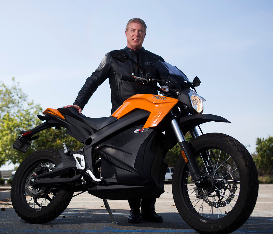 . Curt Schwebke, of Los Gatos, photographed with his Zero electric motorcycle near where he works in Santa Clara, Calif., Thursday, May 12, 2016.  Zero Motorcycles are made in Scotts Valley and are at the forefront of the burgeoning electric motorcycle market.  (Patrick Tehan/Bay Area News Group)