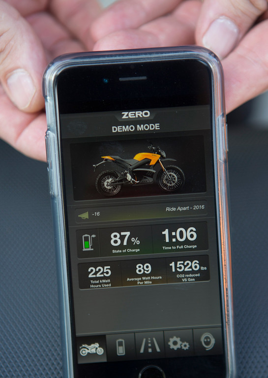 . Curt Schwebke, of Los Gatos, displays the app on his phone that communicates with his Zero electric motorcycle, photographed near where he works in Santa Clara, Calif., Thursday, May 12, 2016.  Zero Motorcycles are made in Scotts Valley and are at the forefront of the burgeoning electric motorcycle market.  (Patrick Tehan/Bay Area News Group)