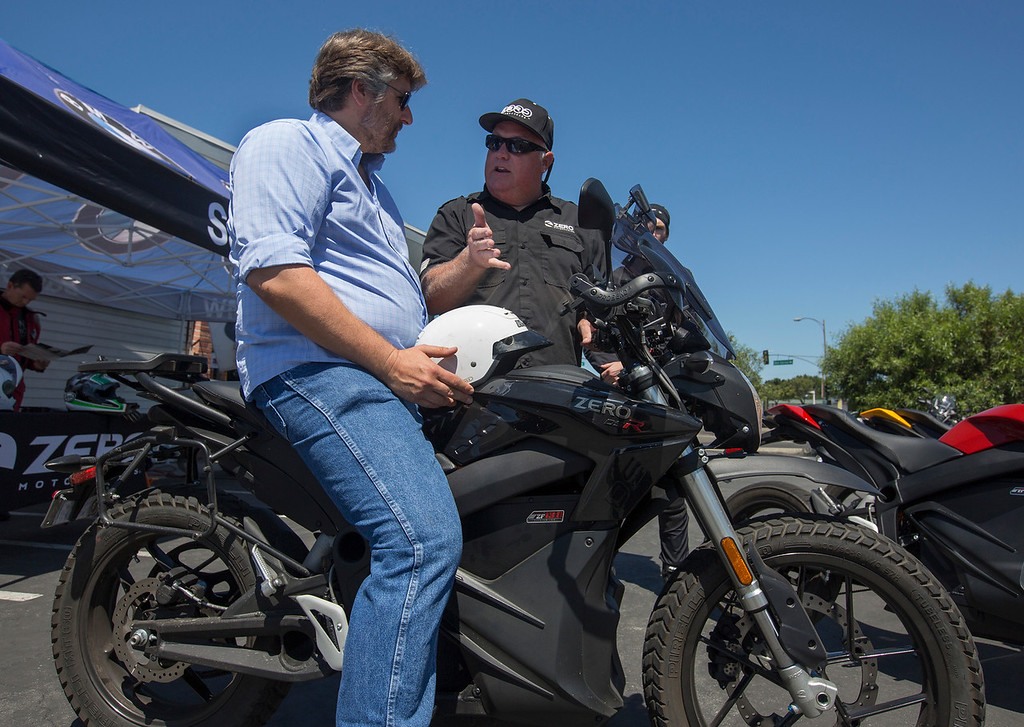 . Jeff Jolin, of Zero Motorcycles, right, talks with Fred Olsson of Cupertino, as Zero Motorcycles holds a demonstration event at San Jose BMW in San Jose, Calif., Saturday, June 24, 2016. There is a burgeoning electric motorcycle market, which includes one of the major players, Zero Motorcycles of Scotts Valley.  (Patrick Tehan/Bay Area News Group)