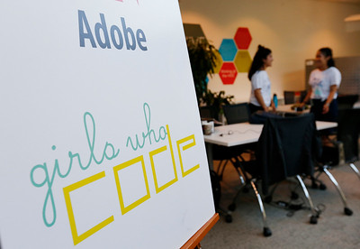 A sign announces a summer program on coding for girls at Adobe Systems in San Jose, Calif., on Tuesday, June 28, 2016. There has been a growth in coding camps to get girls interested in learning to write code. (Photo by Gary Reyes/Bay Area News Group)
