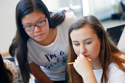 Teachers assistant, Maggie Chang, 17, left, helps student, Kristen Miller, 17, right, work on a coding project during a summer program at Adobe Systems in San Jose, Calif., on Tuesday, June 28, 2016. There has been a growth in coding camps to get girls interested in learning to write code. (Photo by Gary Reyes/Bay Area News Group)