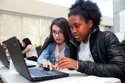 Edith Gonzalez, 16, left, and Hannah Leonard, 16, right, work together on a coding project during a summer program at Adobe Systems in San Jose, Calif., on Tuesday, June 28, 2016. There has been a growth in coding camps to get girls interested in learning to write code. (Photo by Gary Reyes/Bay Area News Group)