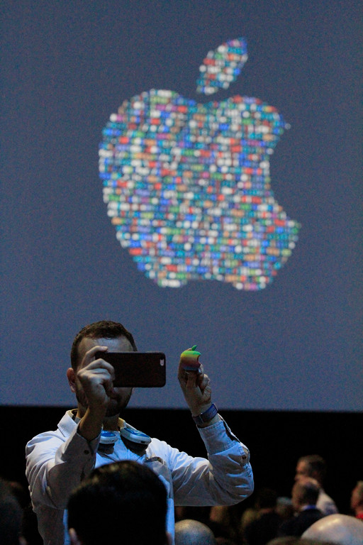 . An attendee takes a selfie with an apple before the start of the Apple Worldwide Developer Conference held at the Bill Graham Civic Auditorium in San Francisco, Calif., on Monday, June 13, 2016. (Laura A. Oda/Bay Area News Group)
