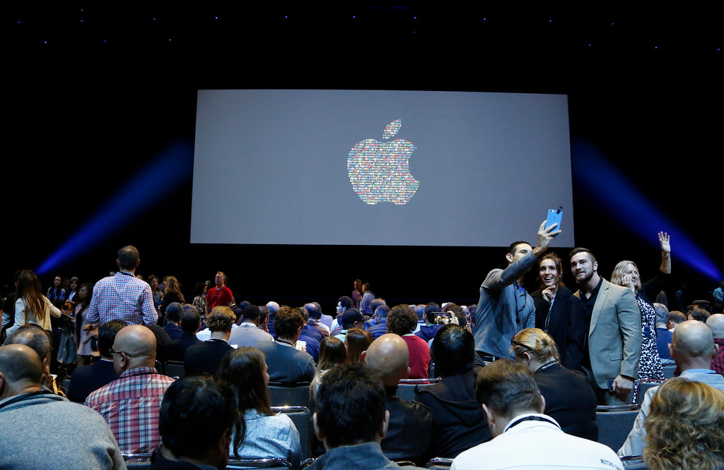 . Attendees take photos before the start of the Apple Worldwide Developer Conference held at the Bill Graham Civic Auditorium in San Francisco, Calif., on Monday, June 13, 2016. (Laura A. Oda/Bay Area News Group)