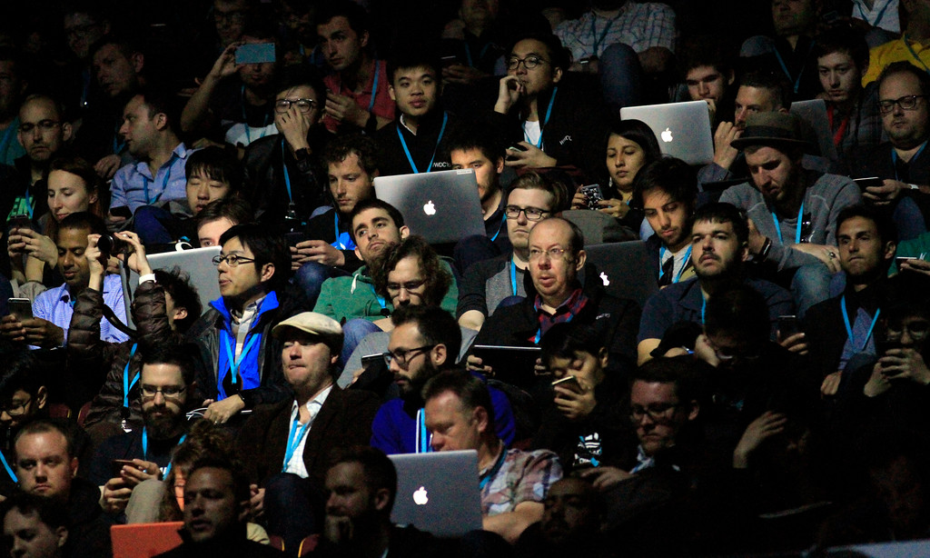 . Attendees wait for the start of the Apple Worldwide Developer Conference held at the Bill Graham Civic Auditorium in San Francisco, Calif., on Monday, June 13, 2016. (Laura A. Oda/Bay Area News Group)