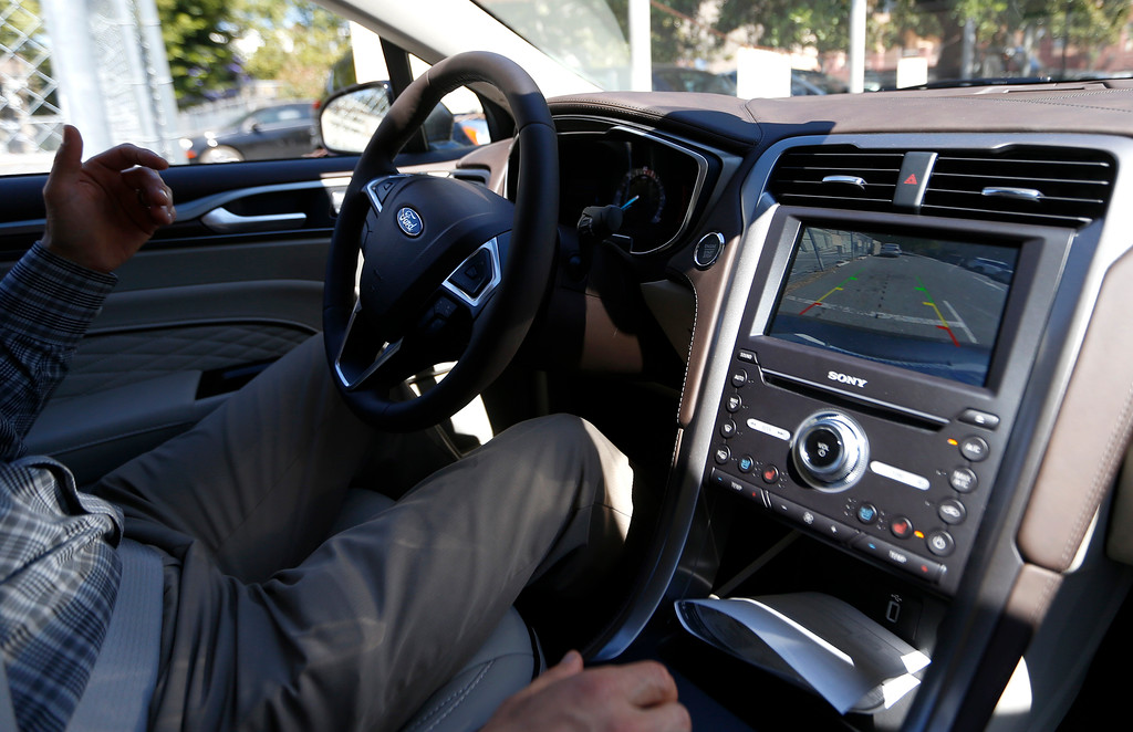 . Troy Wolverton, Mercury News technology columnist, lets go of the steering wheel while after he engaged the parking assist in a 2017 Ford Fusion Energi plug-in hybrid Platinum model in San Jose, Calif., on Wednesday, July 13, 2016. Wolverton controlled the brake and accelerator but not the steering wheel.  (Nhat V. Meyer/Bay Area News Group)