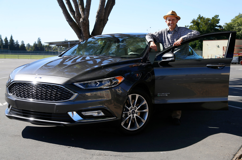 . Troy Wolverton, Mercury News technology columnist, poses for a portrait with a 2017 Ford Fusion Energi plug-in hybrid Platinum model in San Jose, Calif., on Wednesday, July 13, 2016. (Nhat V. Meyer/Bay Area News Group)