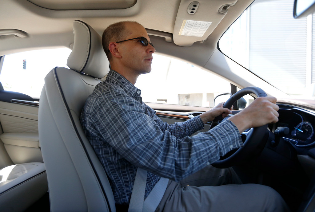 . Troy Wolverton, Mercury News technology columnist, drives a 2017 Ford Fusion Energi plug-in hybrid Platinum model in San Jose, Calif., on Wednesday, July 13, 2016. (Nhat V. Meyer/Bay Area News Group)