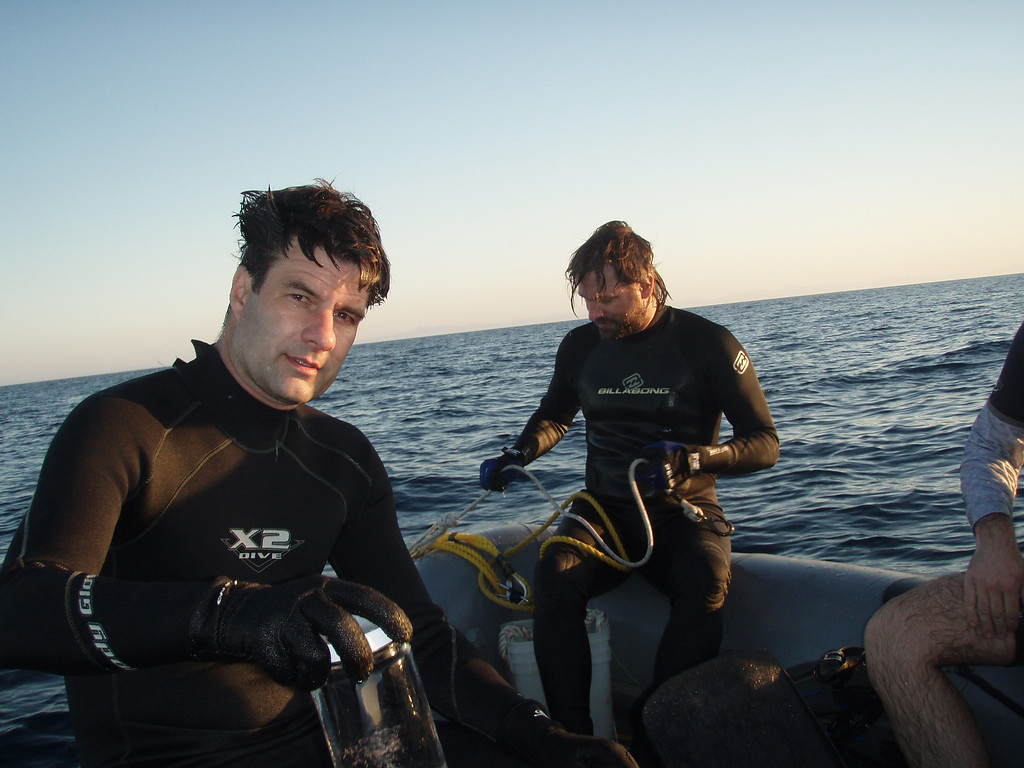 . Monterey Bay Aquarium Research Institute researcher Steve Haddock, left, is pictured preparing for an undated research dive. Haddock created JellyWatch to chart the movement of jellyfish through global seas. (Leane Elder/MBARI)