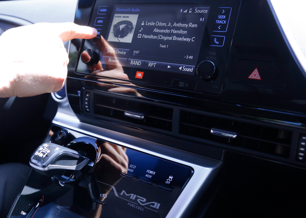 . Troy Wolverton, Mercury News technology columnist, uses the touchscreen display inside the 2016 Toyota Mirai, a hydrogen fuel cell vehicle, in San Jose, Calif., on Wednesday, June 22, 2016. (Nhat V. Meyer/Bay Area News Group)