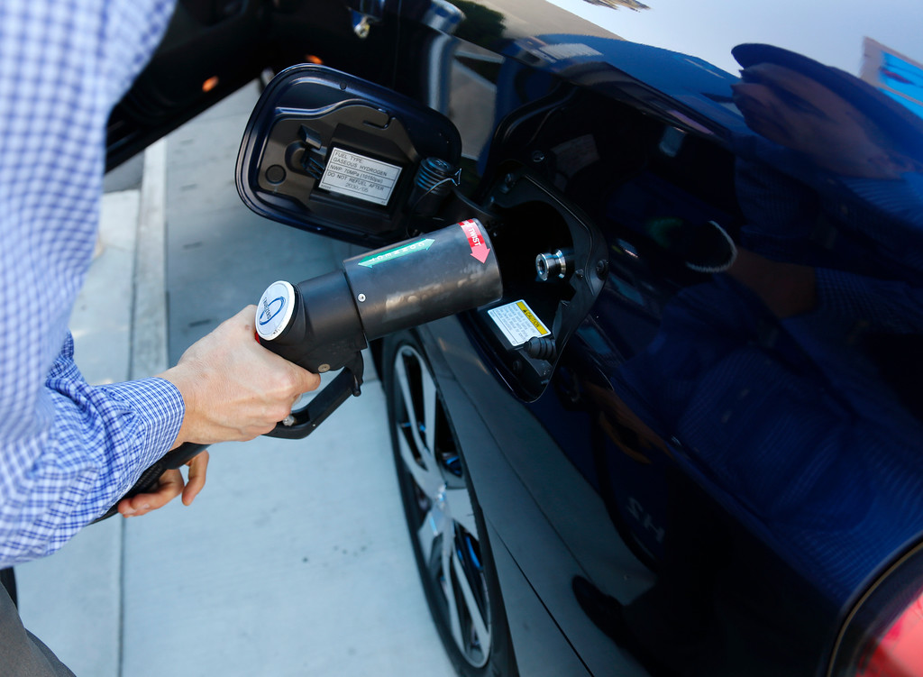 . Troy Wolverton, Mercury News technology columnist, prepares to refuel a 2016 Toyota Mirai, a hydrogen fuel cell vehicle, at a station at E. Brokaw Road and N. First St. in San Jose, Calif., on Wednesday, June 22, 2016. (Nhat V. Meyer/Bay Area News Group)