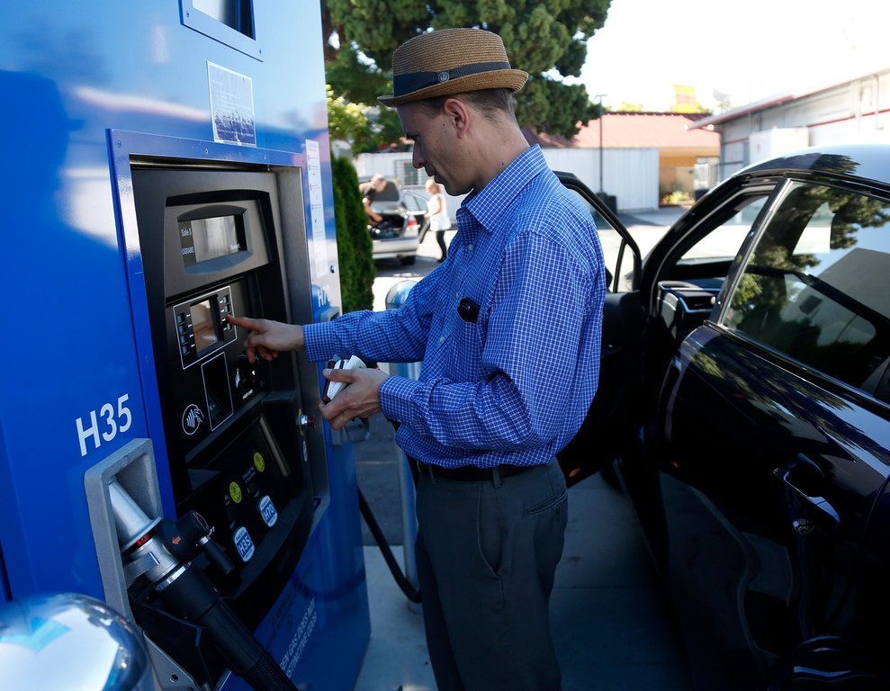 . Troy Wolverton, Mercury News technology columnist, navigates the refueling station for a 2016 Toyota Mirai, a hydrogen fuel cell vehicle, at the station at E. Brokaw Road and N. First St. in San Jose, Calif., on Wednesday, June 22, 2016. (Nhat V. Meyer/Bay Area News Group)