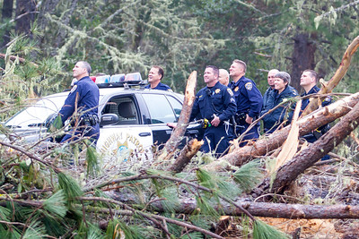 Another group of officers watch the extraction operation of the second and third tree sitters. Photo by Steve Eberhard