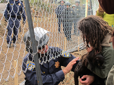 The officer gently hands off the rescued kitty to Tara. By The Willits News Publisher Debbie Clark