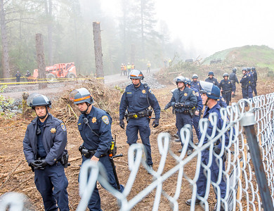 Large contingent of California Highway Patrol officers guarding the fence line near the location of the second and third tree sitters, Jean Daniel Weilbach and Martin Reign Katz. Photo by Steve Eberhard