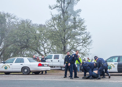 Will Parrish being pulled to the side of Highway 101 prior to arrest as Sara Grusky looks on. Photo by Steve Eberhard