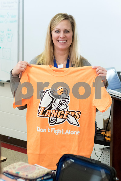 """Sam Buckner for Shaw Media.<br /> Marissa Dobie holds up her shirt which reads """"Lancers don't fight alone"""" in support of her son Jake who has been diagnosed with Leukemia on Thursday February 1, 2018."""