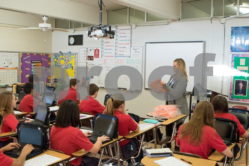 Sam Buckner for Shaw Media.<br /> Marissa Dobie hands out shirts to her 8th grade class on Thursday February 1, 2018 that show support for her son Jake who has been diagnosed with Leukemia.
