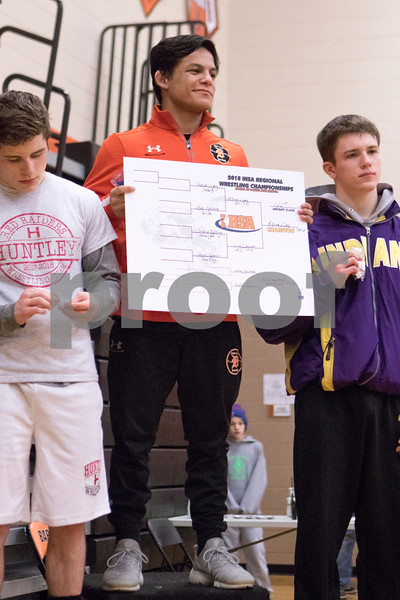 Sam Buckner for Shaw Media.<br /> Fabian Lopez of Dekalb holds up the 126lb bracket after winning the Dekalb regional on Saturday February 3, 2018.