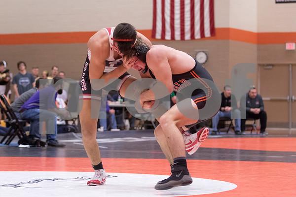 Sam Buckner for Shaw Media.<br /> Jacobe Schmerbach of Dekalb tries to takedown Huntley's Juan Quiroz during the 170lb finals on Saturday February 3, 2018 in Dekalb.