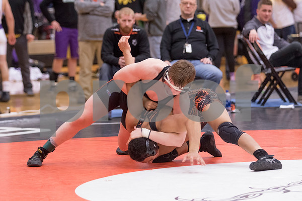 Sam Buckner for Shaw Media.<br /> Christian Komitas of Dekalb puts an arm bar on Harlem's Chad Richards during the 152lb finals of the Dekalb regional on Saturday February 3, 2018.