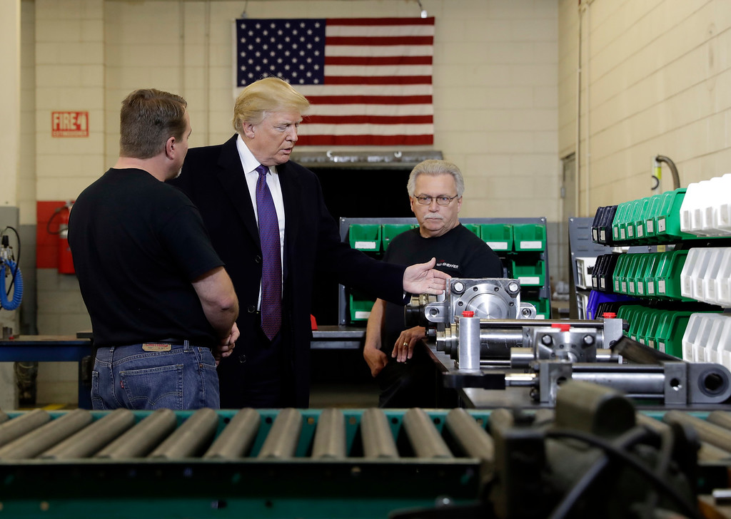 . President Donald Trump participates in a tour of Sheffer Corporation to promote his tax policy, Monday, Feb. 5, 2018, in Blue Ash, Ohio. (AP Photo/Evan Vucci)