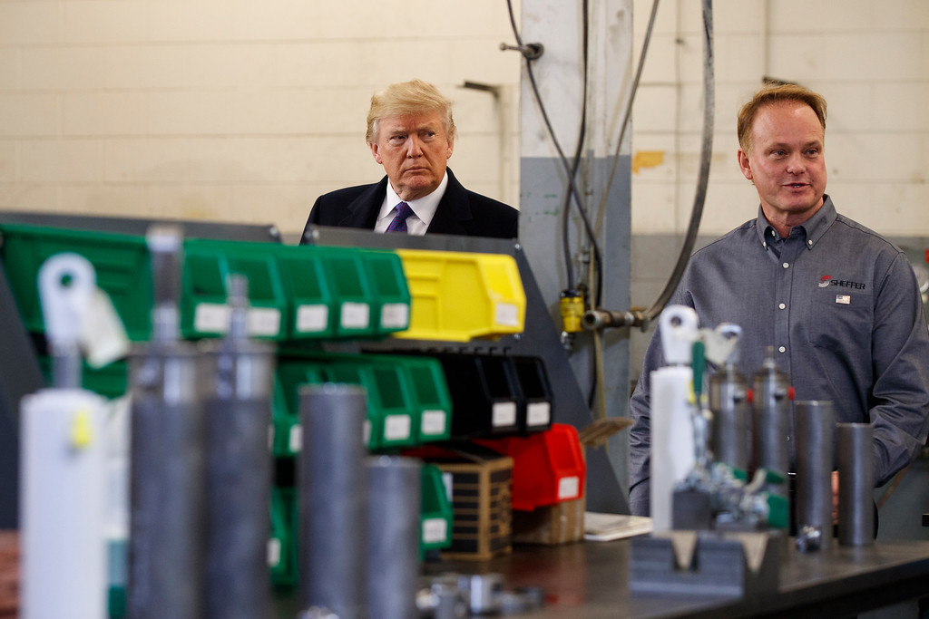 . President Donald Trump participates in a tour of Sheffer Corporation during a visit to promote his tax policy, Monday, Feb. 5, 2018, in Blue Ash, Ohio. (AP Photo/Evan Vucci)
