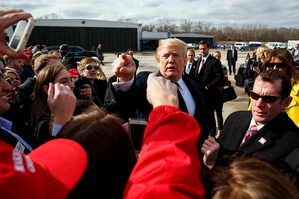 . President Donald Trump greets supporters after arriving at Cincinnati Municipal Lunken Airport, Monday, Feb. 5, 2018, in Cincinnati. (AP Photo/Evan Vucci)