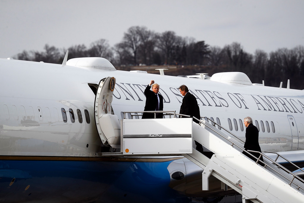. President Donald Trump prepares to board Air Force One before leaving Cincinnati Municipal Lunken Airport, Monday, Feb. 5, 2018, in Cincinnati. (AP Photo/John Minchillo)