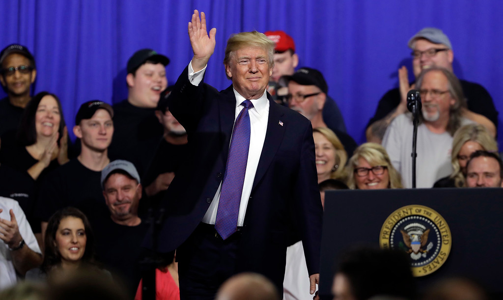 . President Donald Trump waves after speaking on tax policy during a visit to Sheffer Corporation, Monday, Feb. 5, 2018, in Blue Ash, Ohio. (AP Photo/Evan Vucci)