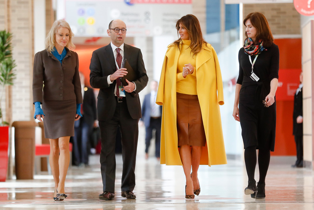 . First Lady Melania Trump, center right, Jane Portman, left, and Kellyanne Conway, right, meet with Michael Fisher, president of Cincinnati Children\'s Hospital at their Medical Center, Monday, Feb. 5, 2018, in Cincinnati. (AP Photo/John Minchillo)