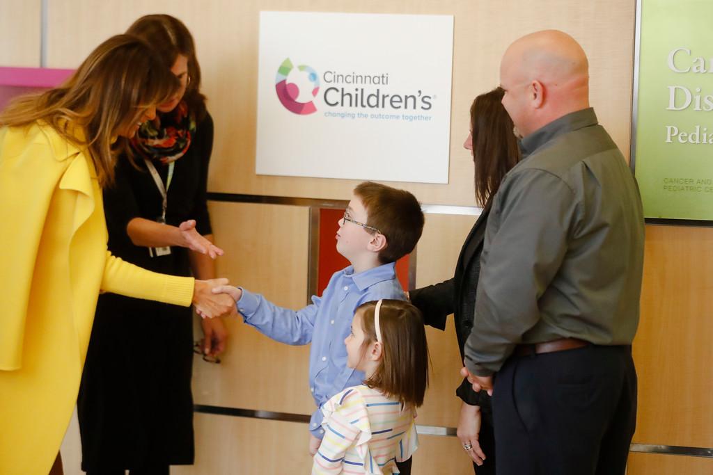 . First Lady Melania Trump, in yellow, meets with children at the Cincinnati Children\'s Hospital Medical Center, Monday, Feb. 5, 2018, in Cincinnati. (AP Photo/John Minchillo)