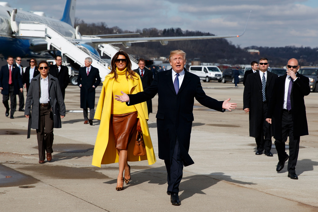. President Donald Trump and first lady Melania Trump walk to greet supporters after arriving at Cincinnati Municipal Lunken Airport, Monday, Feb. 5, 2018, in Cincinnati. (AP Photo/Evan Vucci)