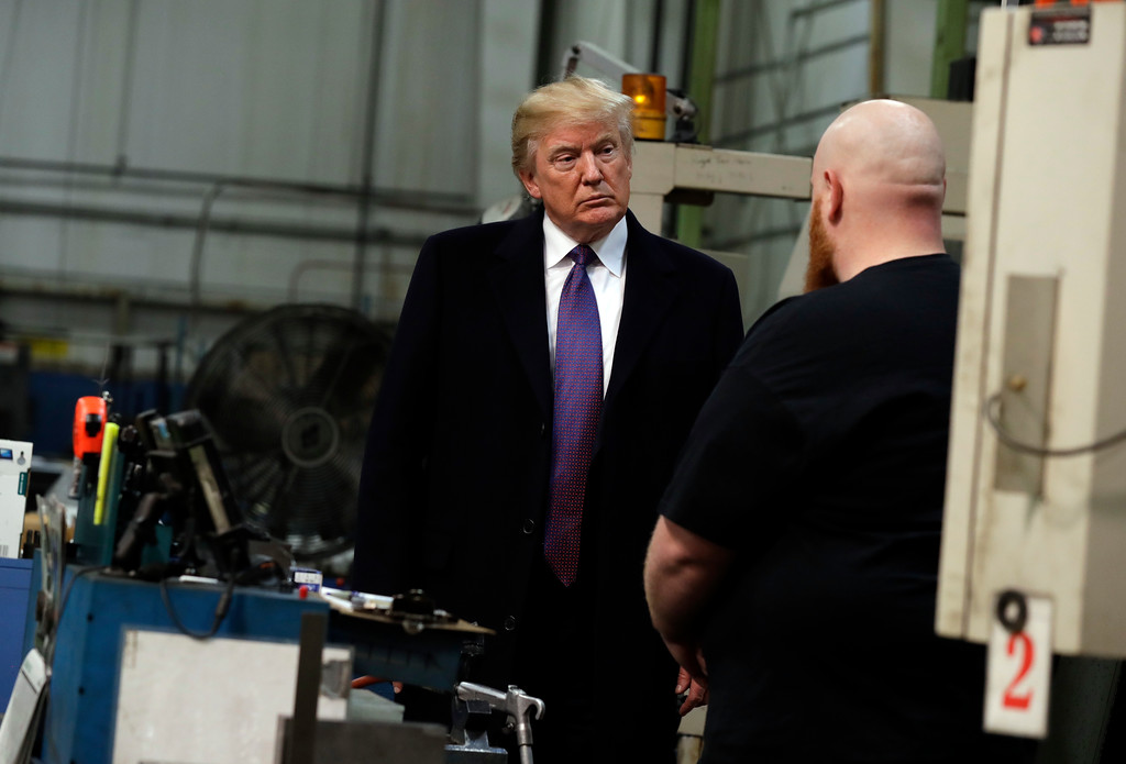 . President Donald Trump talks to a workers as he participates in a tour of Sheffer Corporation to promote his tax policy, Monday, Feb. 5, 2018, in Blue Ash, Ohio. (AP Photo/Evan Vucci)