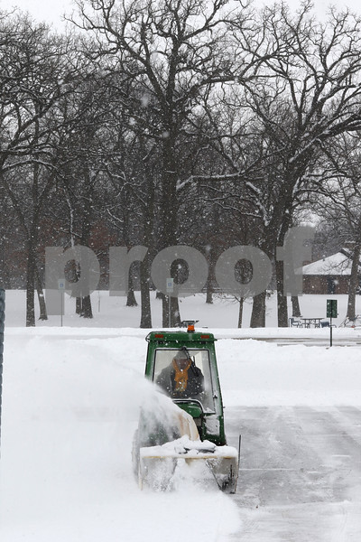 Mark Busch - mbusch@shawmedia.com<br /> DeKalb Park District employee Jeff Zweifei plows the ice rink at Hopkins Park Wednesday in preparation for this Sunday's POLARpalooza Winter Festival. More snow is expected before then with additional accumulation making for a wintery weekend.