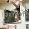 Sam Buckner for Shaw Media.<br /> Aleah Leman flips upside down during her balance beam routine on Wednesday February 8, 2017.