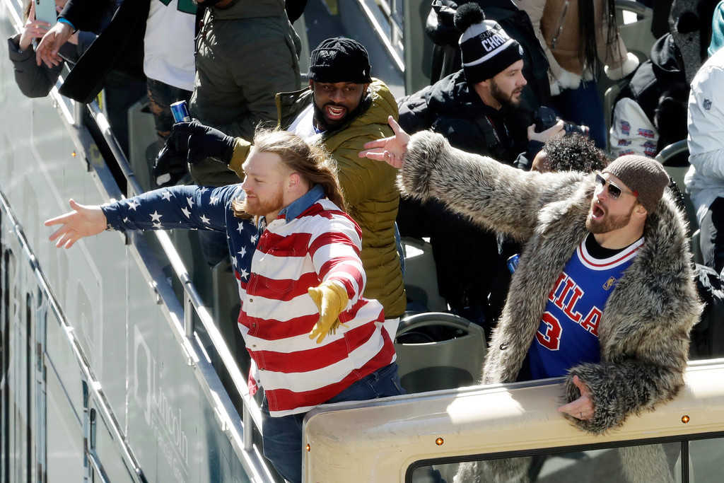 . Philadelphia Eagles\' Chris Long, from right, Fletcher Cox and Beau Allen celebrate during a Super Bowl victory parade, Thursday, Feb. 8, 2018, in Philadelphia. The Eagles beat the New England Patriots 41-33 in Super Bowl 52. (AP Photo/Matt Slocum)