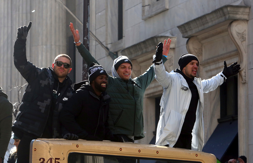 . Philadelphia Eagles NFL football team wide receivers Zach Ertz, left, and Mack Hollins, second from right, ride with teammates in the Eagles team parade and celebration Thursday Feb. 8, 2018, in Philadelphia. The Eagles defeated The New England Patriots in Super Bowl 52. (AP Photo/Jacqueline Larma)