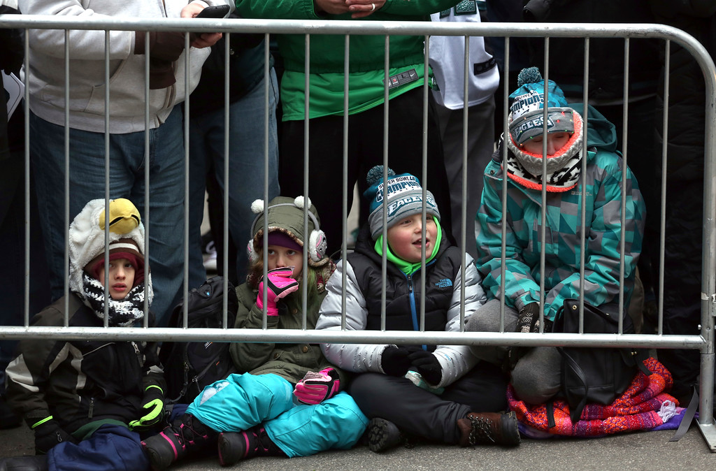 . Philadelphia Eagles NFL football team fans wait behind a barricade for the start of the Eagles team parade and celebration Thursday Feb. 8, 2018, in Philadelphia. The Eagles defeated the New England Patriots in Super Bowl 52. (AP Photo/Jacqueline Larma)