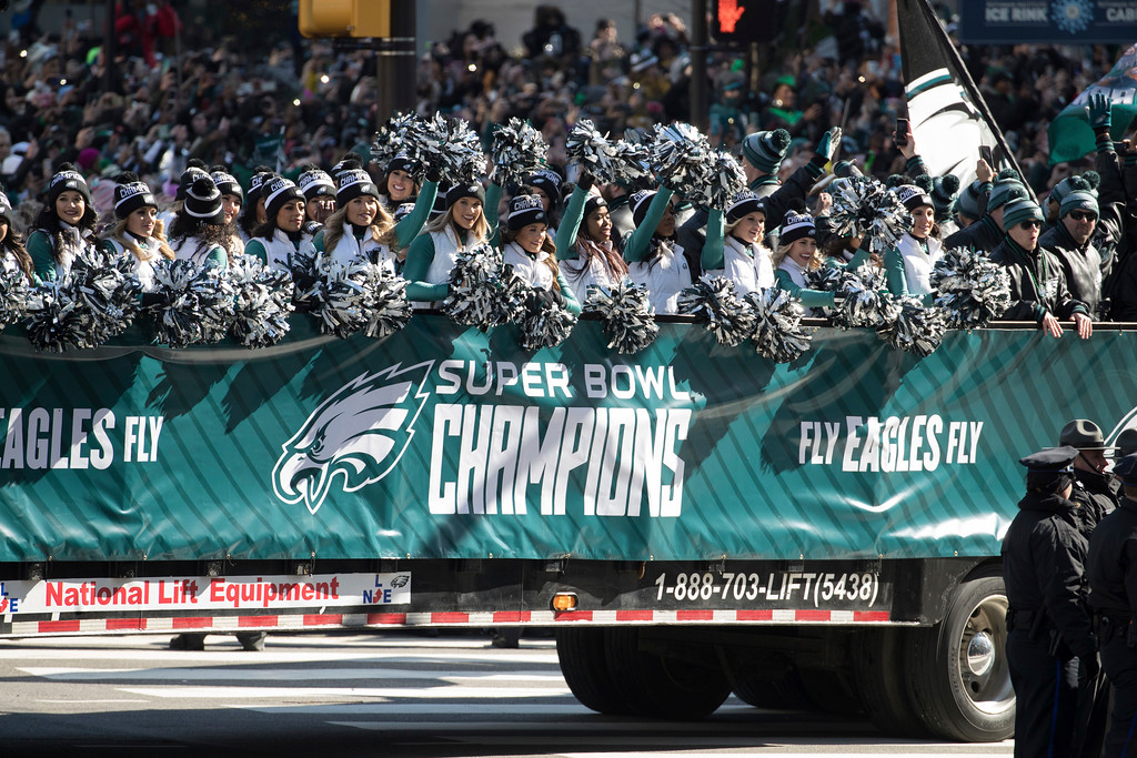 . Philadelphia Eagles NFl football team cheerleaders waves during a Super Bowl victory parade, Thursday, Feb. 8, 2018, in Philadelphia. The Eagles beat the New England Patriots 41-33 in Super Bowl 52. (AP Photo/Christopher Szagola)