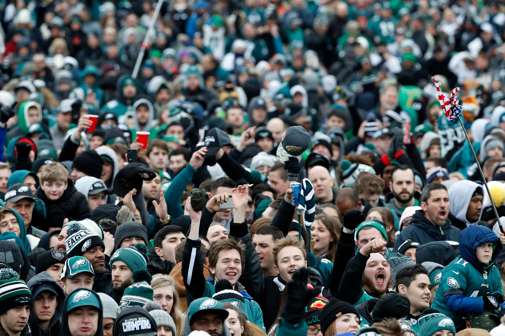 . Fans cheer as they watch a replay of Super Bowl 52 in front of the the Philadelphia Museum of Art before a Super Bowl victory parade for the Philadelphia Eagles NFL football team, Thursday, Feb. 8, 2018, in Philadelphia. The Eagles beat the New England Patriots 41-33 in Super Bowl 52. (AP Photo/Alex Brandon)