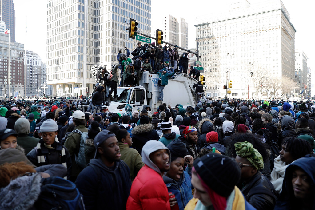 . Philadelphia Eagles\' fans celebrate on a garbage truck outside of City Hall after a Super Bowl victory parade, Thursday, Feb. 8, 2018, in Philadelphia. The Eagles beat the New England Patriots 41-33 in Super Bowl 52. (AP Photo/Matt Slocum)